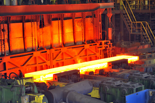 Hot steel on conveyor in plant